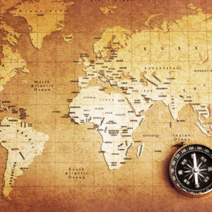 Old Compass on World Map